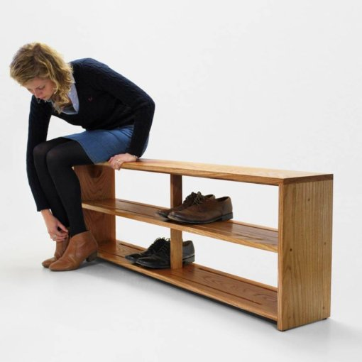 Oak Shoe Bench in use. Bench seat with footwear storage below.